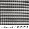 Black and white checked fabric background - stock photo