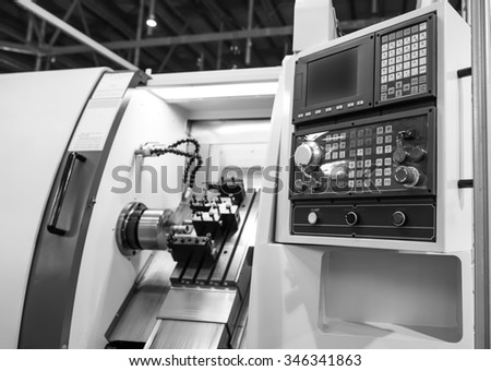 Black and white computer control panel lathe with numerical control