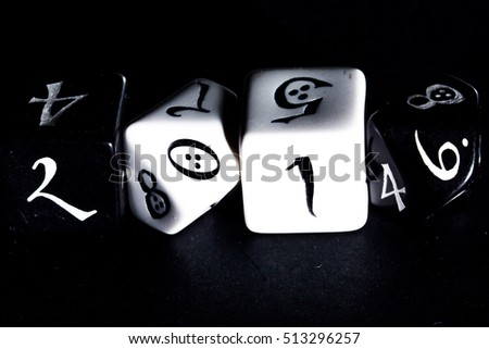 Black and white dice on black texture