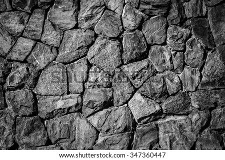 black and white filter photo effect of  stone wall  texture