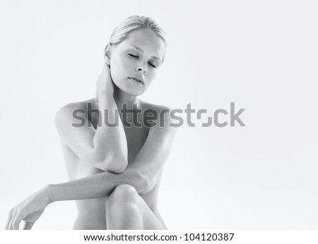 Stock Photo of Young naked woman holding scalpel, close-up