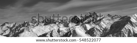 Black and white panorama of winter mountains. Caucasus Mountains. View from ski slope of mount Elbrus.