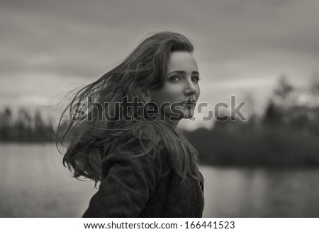 black and white photo of young girl outdoor