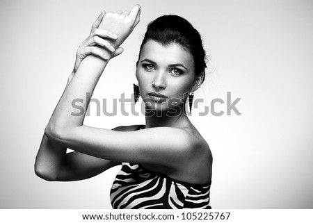 Black and white portrait of beautiful woman  in ornament dress with earring