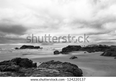 Black and white take of a rocky Pacific shore in Costa Rica