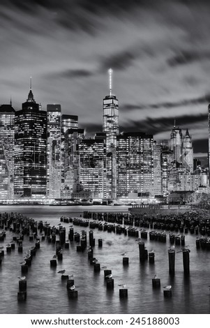 Black and white vertical image of lower manhattan and the business and wall street district from across the east River