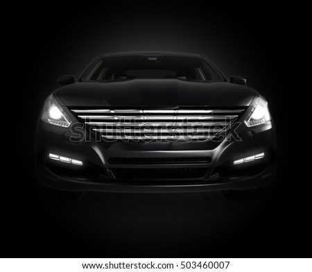 black car isolated on black background - generic, un-branded sedan, 3D rendering