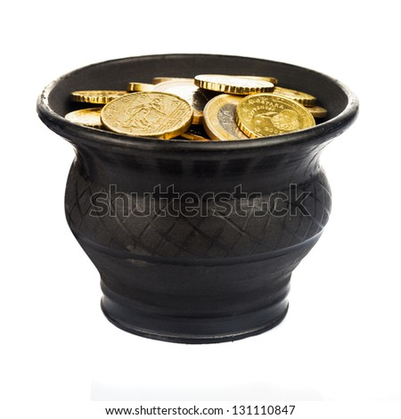 Black ceramic pot with golden coins isolated on white