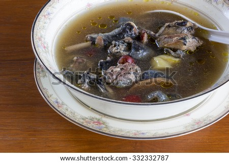 Black chicken soup cooked ; chinese food