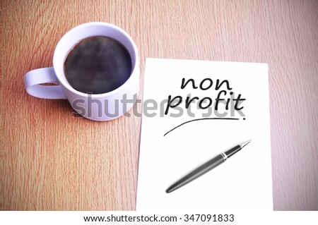 Black coffee on the table with note writing non profit
