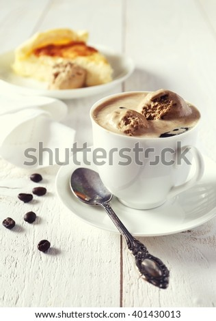 Black coffee with ice cream and cheesecake