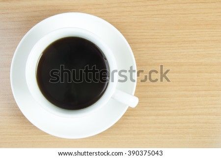 Black coffee with top view on wooden background