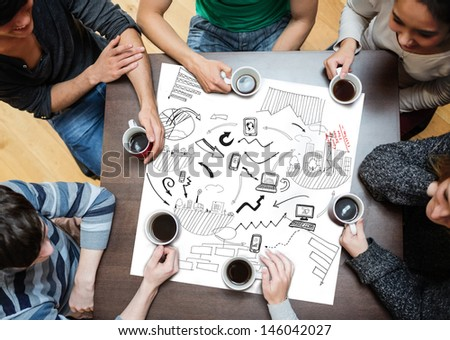 Black drawings of charts drew on a poster during a meeting