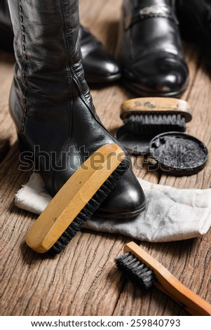 black leather boots with shoe maintenance set