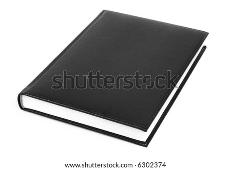 Black leather covered book isolated over white background
