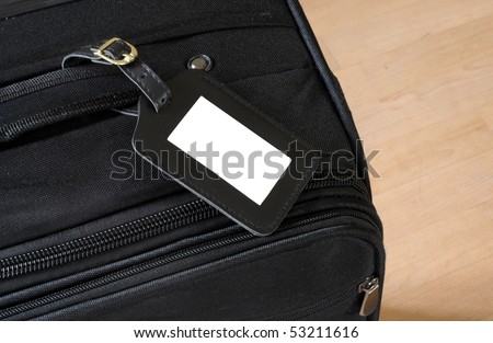 black leather label on a black suitcase