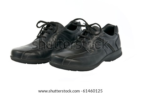 Black man's autumn shoes isolated on white