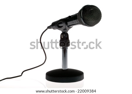Black microphone with lead on a stand isolated on a white background.