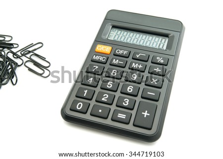 black office calculator and clips on white