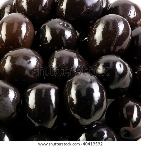 black olives isolated on white background. Close up .