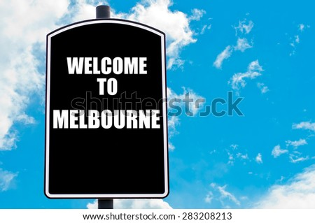 Black road sign with greeting message WELCOME TO MELBOURNE isolated over clear blue sky background with available copy space. Travel destination concept  image