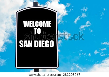 Black road sign with greeting message WELCOME TO  SAN DIEGO isolated over clear blue sky background with available copy space. Travel destination concept  image