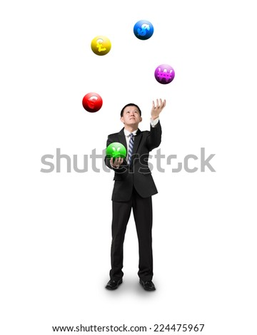 black suit businessman juggling currency symbol balls isolated on white