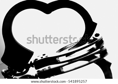 Black & white abstract handcuffs.