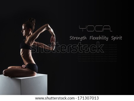 Black yoga background with flexible slim woman