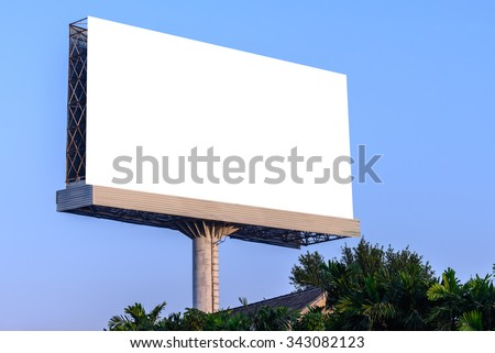 Blank billboard against blue sky for advertisement.