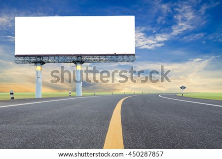 Blank billboard for your advertisement with space for text on road curve,with green grass and blue sky white cloud.