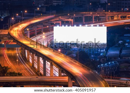 Blank billboard ready for new advertisement at Motorway, Expressway, Freeway in modern city downtown, urban view at night time