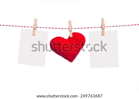 Blank instant photo and red paper heart hanging on the clothesline. Isolated on white.