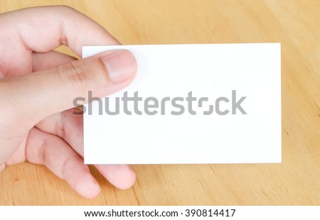 Blank name card in hand background, business concept