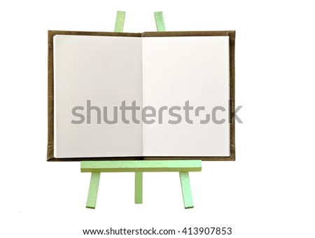 Blank note book on green wooden Tripod isolated on white background.