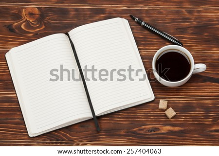Blank Open Notepad. Cup Of Coffee. Wooden Background.