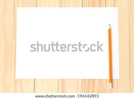 Blank paper with pencil on wooden background