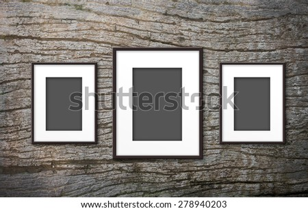 blank photo frame on old wood background