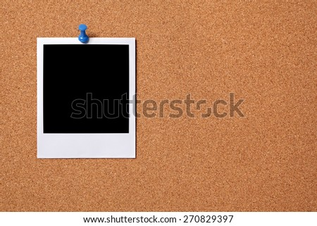 Blank photo print, pushpin, cork background.  Copy space