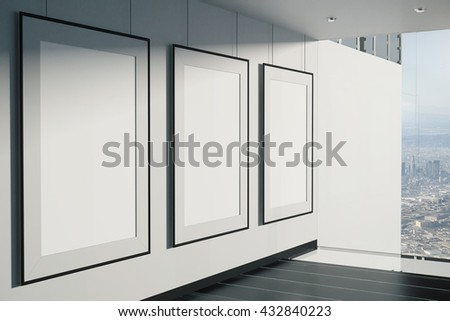 Blank picture frames in room with concrete wall, black floor and window with city view. Mock up, 3D Rendering