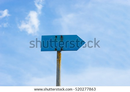 blank road sign with rust and pole against blue sky background