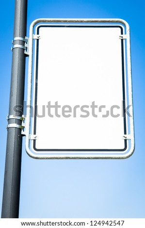 blank sign in front of blue sky