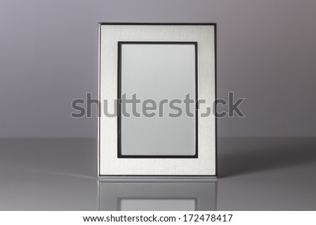 Blank silver picture frame at the desk