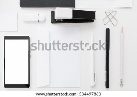 Superior Blank Smartphone With Stationery Flat Lay. Top View On Set Of Black And White  Office