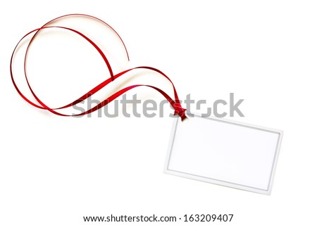 Blank white gift tag tied with curling red ribbon.  Isolated on white.