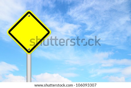 blank yellow traffic sign with blue sky background
