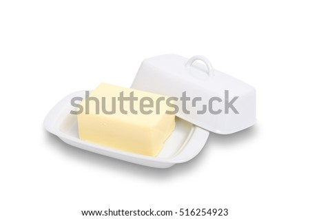 Block of butter in white ceramic butter dish isolated on white with path