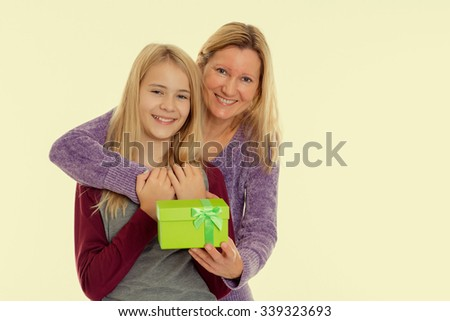 blond girl and woman with a green gift box