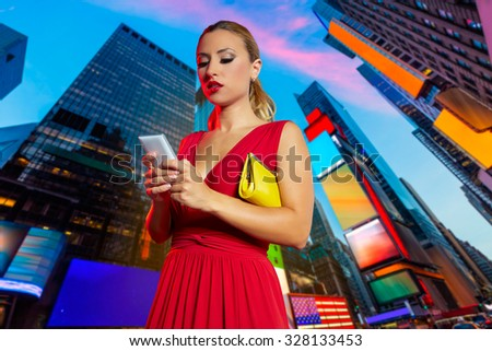 Blond girl red dress smartphone chat writing in Times Square of New York Photomount