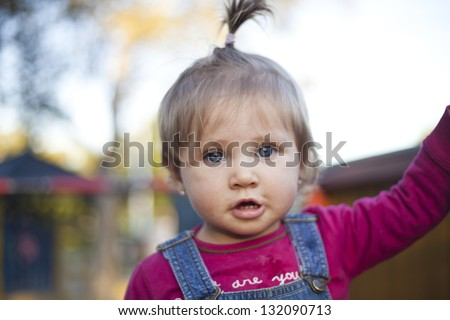 Blond hair blue eyed baby girl with pony tail